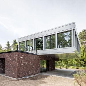 Cantilevered aluminum and brick facade