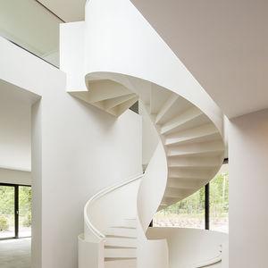 Bold white spiral staircase