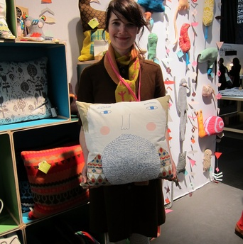 On to Donna Wilson's booth, where I was thrilled to run into the star herself. Here she is holding her favorite new item from the collection: a two-sided Fergus cushion.