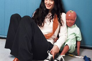 Laura Thackray, a mechanical engineer for Volvo, with a traditional crash-test dummy. Thackray developed the world's first virtual pregnant crash-test dummy, Linda (illustration below).