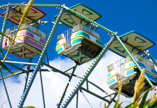 """This photo by <a href=""""http://www.flickr.com/photos/michelledwright/"""">Michelle Wright</a> highlights the bright colors of the rides and gives a cheery impression of the place."""