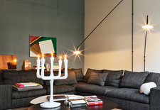 Modern living room with Flexform sofa and Jens Fager candelabra