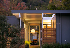 a renovated Eichler home's doorway at night