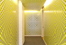 Graphic yellow wallpaper in a hallway
