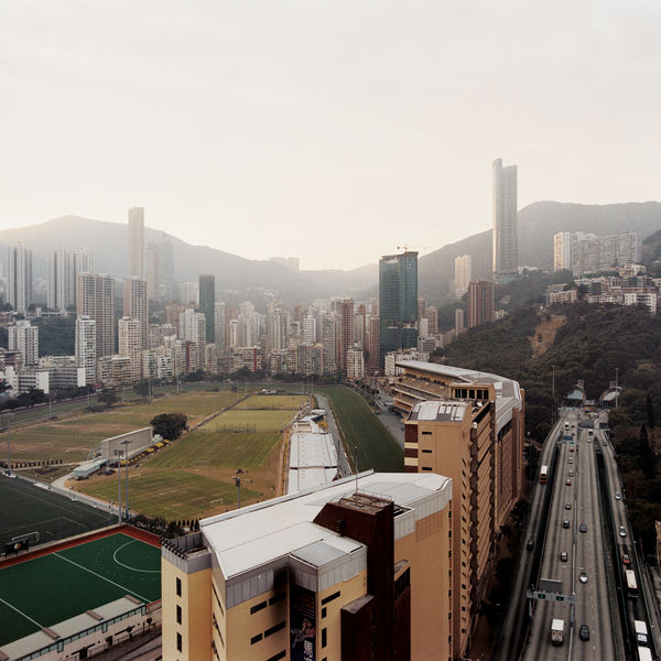 Often portrayed as little more than a dense, vertical sea of urbanity, Hong Kong's lush Botanic Gardens, surprising beaches, and mountaintop vistas are often forgotten. We examine it all, from the ever-shrinking harbor to the bustle of Kowloon.
