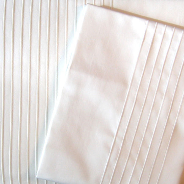 white pleated bedding by Loop