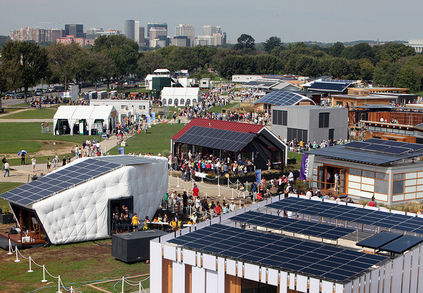 Visitor tour the U.S. Department of Energy Solar Decathlon 2011 in Washington, D.C., Friday, Sept. 30, 2011, with Arlington, VA, left, and the Lincoln Memorial, right, in the background. (Credit: Stefano Paltera/U.S. Department of Energy Solar Decathlon)