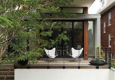 pink lerner residence outside deck butterfly chairs
