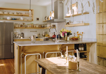Charleston renovation kitchen interior with wood table and hanging light fixtures