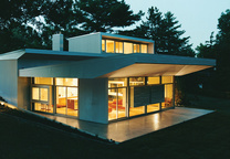 Exterior of Cincinnati renovation with aluminum siding and large glass windows