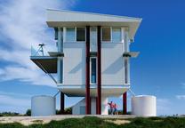White prefab home on red steel beams in Australia