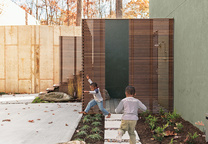 backyard with outdoor shower concrete pavers and wood fence