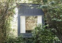 modern landscaping backyard metapod structure