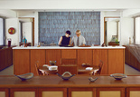 Modern kitchen with Corian countertop and Heath Ceramics tiled wall