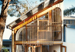 Façade with custom cedar windows and wooden dowels