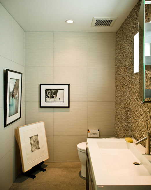 No room in the house is free from Jacobson's keen curatorial eye. The office bathroom is adorned with an original Glen E. Friedman image of skate legend Tony Alva (across from toilet) and a picture of Nathan Fletcher by Mark Oblow (adjacent). Framed on the floor is a George Condo illustration.  Photo by: Dave Lauridsen