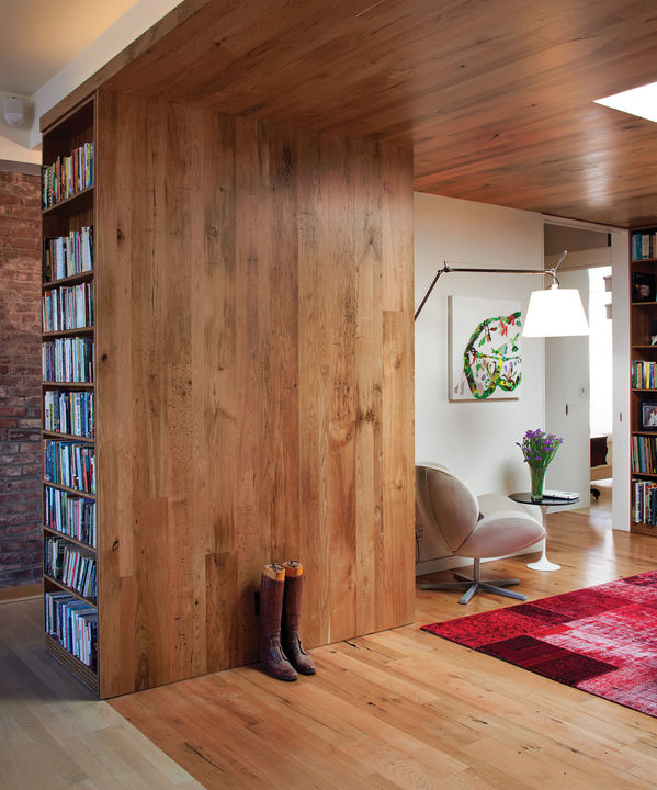 """For Adrian Jones', the decision to line the walls and ceiling of his Brooklyn loft with butternut planks harvested from diseased trees in Vermont was easy. """"I didn't want to chop down a whole lot of trees,"""" he explains matter-of-factly.  Photo by Kevin Cooley.   This originally appeared in In the Loop."""