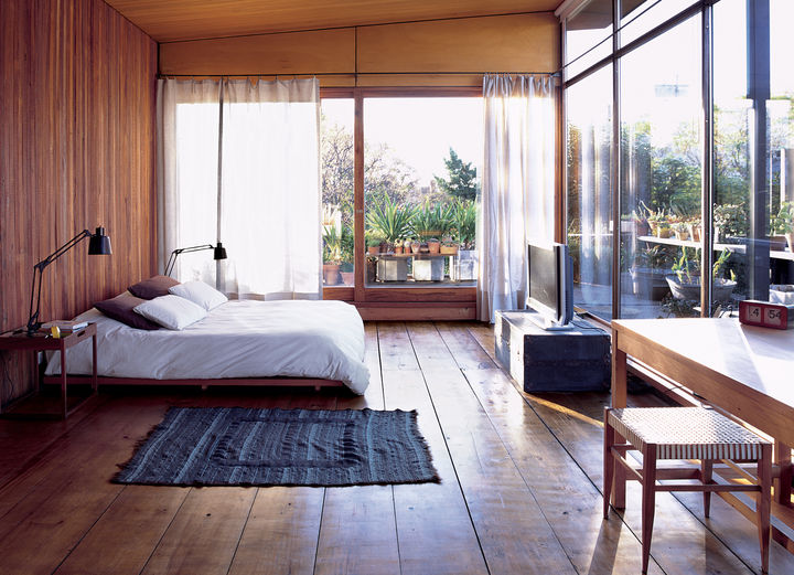 At the height of Argentina's 2001 economic crisis, when foreign building supplies were hard to come by, Buenos Aires-based architect Alejandro Sticotti sought outlocal and recycled materials to realize his dream house. For the floor of the masterbedroom, he chose a reclaimed wood that radiates warmth.    Photo by Cristóbal Palma.   This originally appeared in Net Assets.