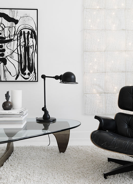 Sofie and her husband searched high and low for a vintage Herman Miller piece, finally finding a 30-year-old Eames lounge chair to complement the family's living room. The carpet is by Hay, the painting is by Claus Carstensen, and the lamp by Jielde.   Courtesy of Vipp.