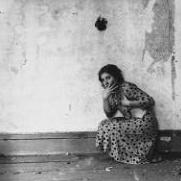 "A photograph by Francesca Woodman titled ""Polka Dots""."