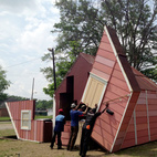 Watch an Unassuming House Unfold into a Community Theater