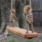 Wooden swing with rope handles