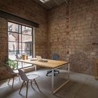 Modern Office Space Carved Out of a Crumbling Brick Building