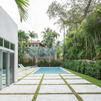 Passive Materials Cool this Bright White Tropical Home