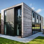 Scenic Country Home Made of Flat-Packed Panels