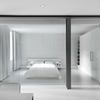 A Futuristic Apartment with a Glass-Enclosed Bedroom