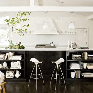 Midcentury kitchen upgrade in Portland with an island-bookshelf