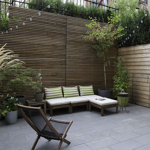 Private garden in Brooklyn with a cedar fence