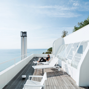 An exterior view of the roof deck and view of Lake Michigan from the Douglas House.
