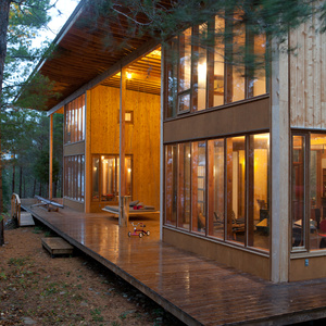 Minimalist wooden house structure with tall windows