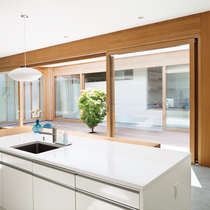 Modern kitchen with white countertops and Eames lounge chair