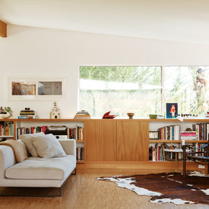 Modern living room with Dadone sofa and cow print rug
