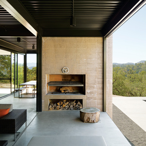 Modern interior with custom fireplace and concrete wall