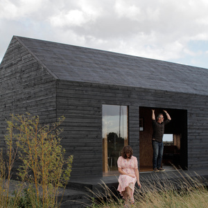Exterior view of modern black farm house renovation