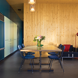 Modern open-plan dining area with Eames Wire Chairs