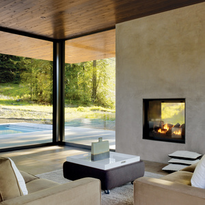 Modern seating area with custom sofas and Knoll ottoman