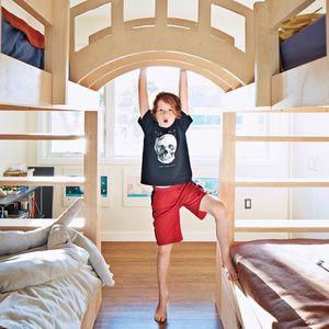 Modern kids bedroom with wooden connecting bunk beds