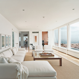 In the living room, there's a black leather Le Corbusier lounge and a Minotti sofa set.