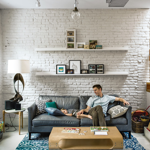Modern living room with exposed painted brick walls
