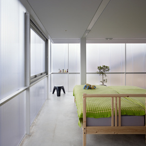 Translucent house in Hiroshima Japan by Suppose with a bright bedroom