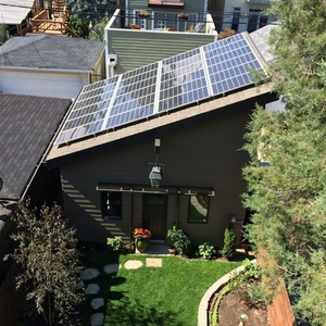 Garage with solar-paneled roof in a Chicago net positive home