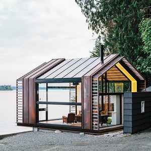 Converted garage in Washington with glass windows and copper siding