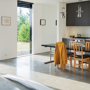 Orcas Island kitchen with dining table and Stelton lanterns