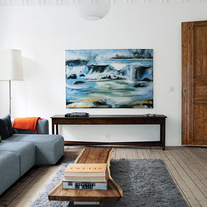 Living room with light wood floors and coffee table made from hardwood slab
