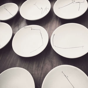Hand-drawn plates at Hueso restaurant in Mexico