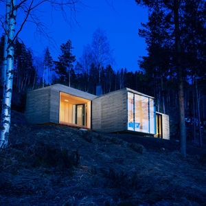 Norwegian cabin with stone exterior and roof and solar panels